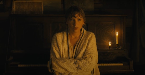 """Taylor Swift wraps herself up in her favorite, knit cardigan in her """"cardigan"""" music video."""