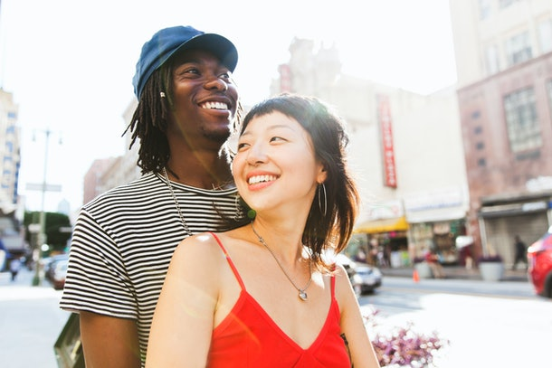 Young couple walking streets