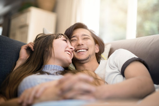 Young couple smiling on couch