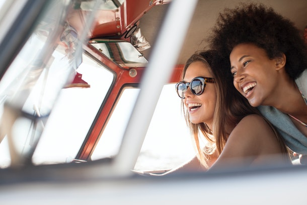 2 young female friends driving