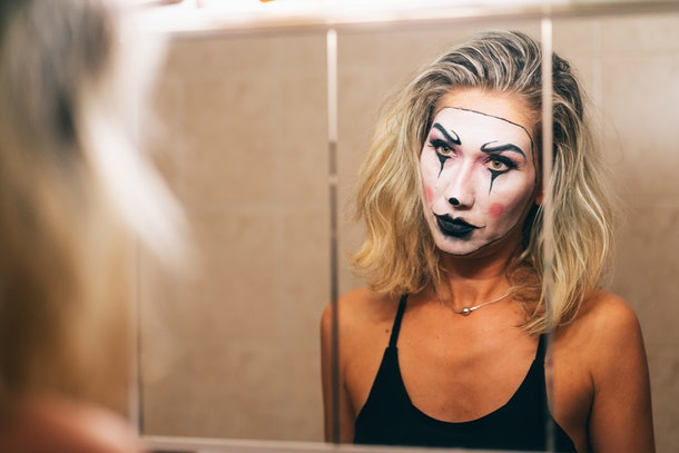 Young woman spooky Halloween makeup