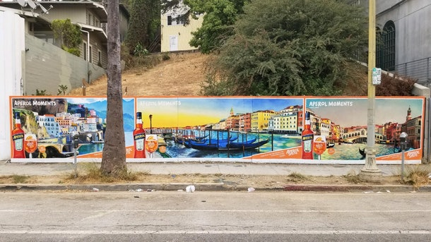 A wall in Los Angeles is painted with an Aperol Spritz mural.