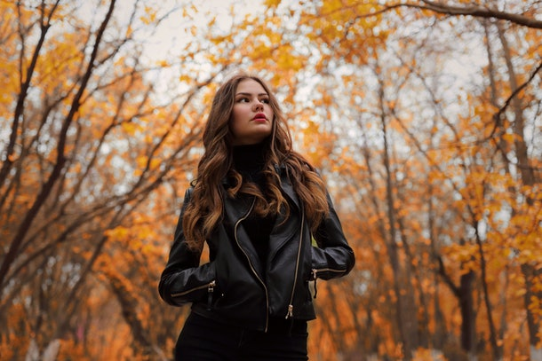 Young woman in leather jacket in autumn