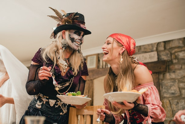 Friends laughing on Halloween