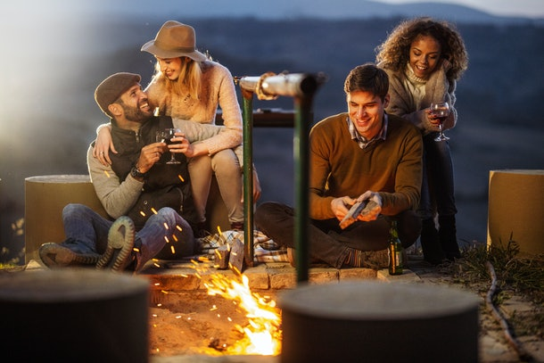 Friends around a bonfire