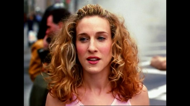 "Carrie Bradshaw, played by Sarah Jessica Parker, walking the New York City streets in the ""Sex and the City"" intro."
