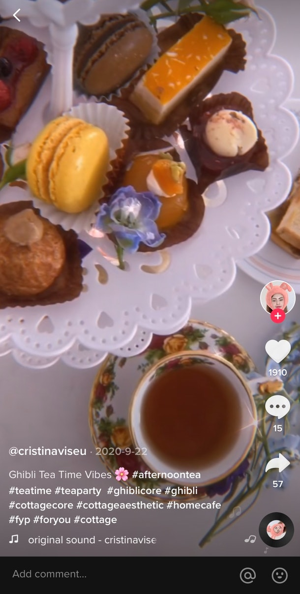 A TikTok video shows an afternoon tea spread complete with pastries, flowers, and tea.