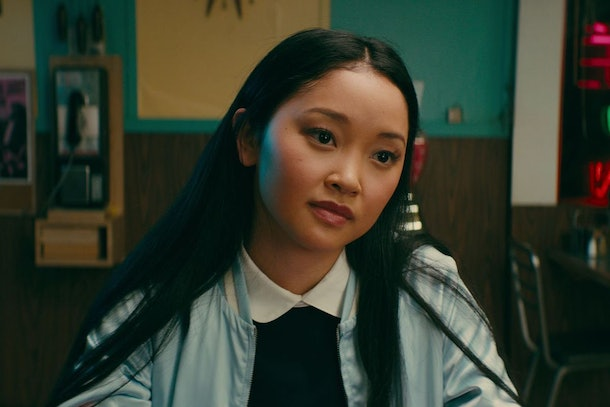 Lara Jean wears a light blue jacket while sitting at a diner in 'To All The Boys I've Loved Before.'