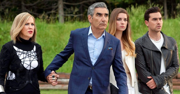 The Rose family looks concerned all together in 'Schitt's Creek.'