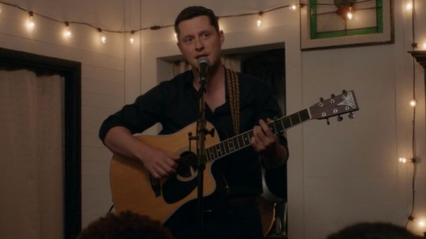 Patrick from 'Schitt's Creek' plays guitar and sings in Rose Apothecary.