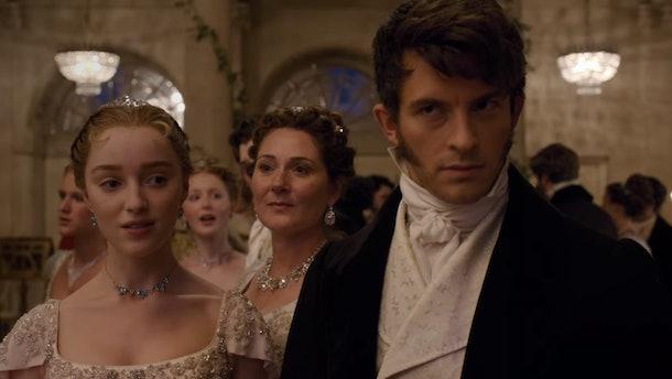 Daphne and Anthony Bridgerton walk around a ballroom at a dance in 'Bridgerton.'