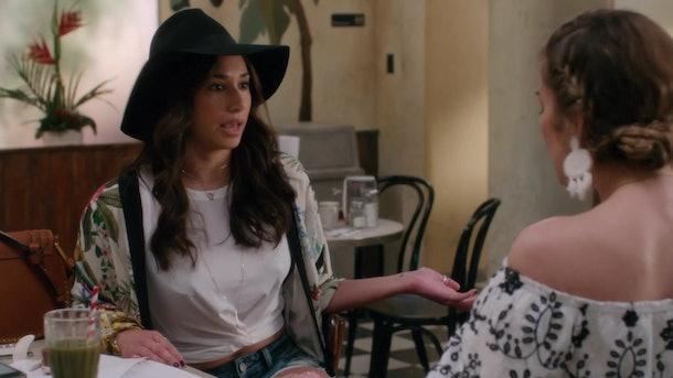 Alexis talks to Klair at the Café Tropical.