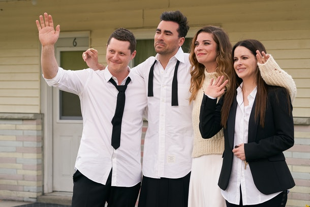 Stevie, Alexis, David, and Patrick wave goodbye to Johnny and Moira in front of the Rosebud Motel in the last episode of 'Schitt's Creek.'