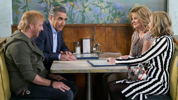 Roland, Jocelyn, Johnny, and Moira all sit in a booth at a diner on 'Schitt's Creek.'