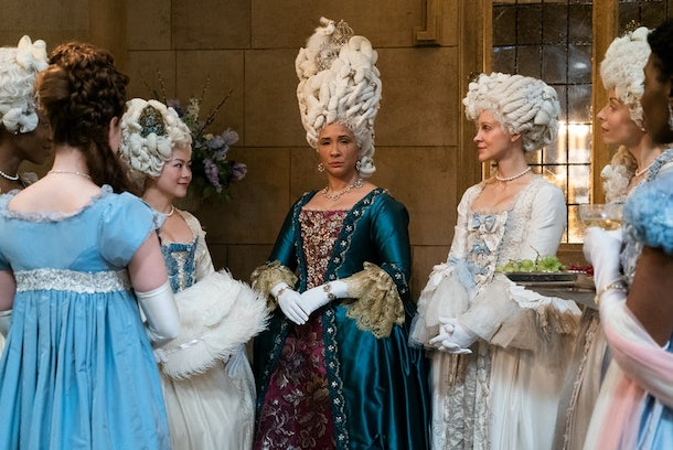 """Queen Charlotte with her ladies-in-waiting at a party in episode eight of """"Bridgerton.°"""