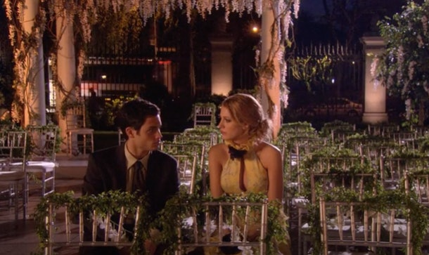 Dan and Serena sit in chairs from an outdoor wedding at night in 'Gossip Girl.'