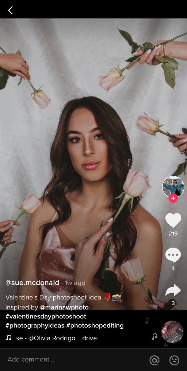 A TikTok user hands herself pink roses in a Valentine's Day picture idea for singles.