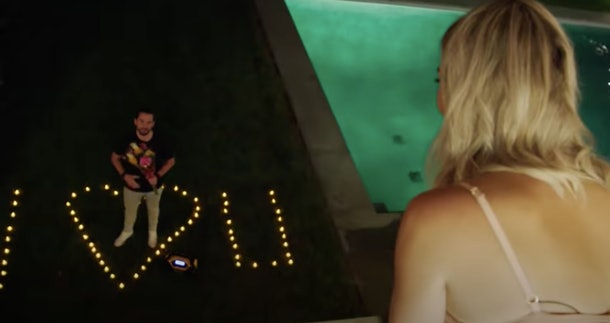 """Stephen surprises Amanda with a lit-up """"I heart U"""" sign by the pool in 'Summer House.'"""