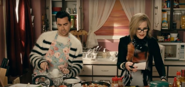 David and Moira Rose cook a meal in their kitchen during an episode of 'Schitt's Creek.'