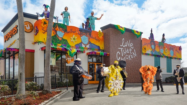 These photos of Popeyes restaurants decorated like Mardi Gras floats are colorful AF.