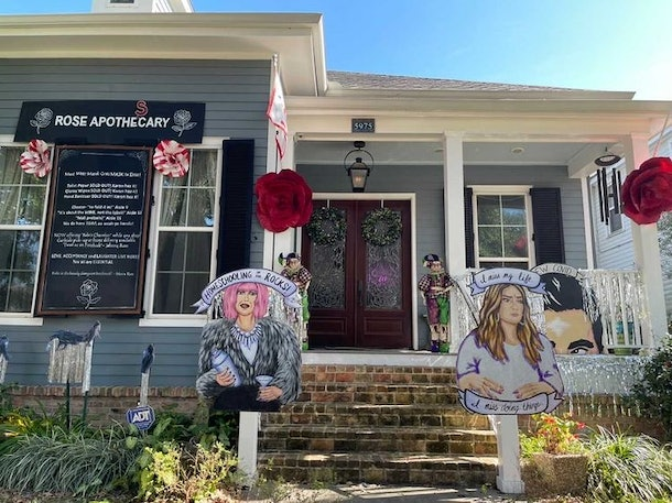 A house decorated like 'Schitt's Creek' for Mardi Gras has a Moira Rose and Alexis Rose cutout in the front.