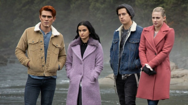 Archie, Veronica, Jughead, and Betty look concerned while they stand next to a river in 'Riverdale.'