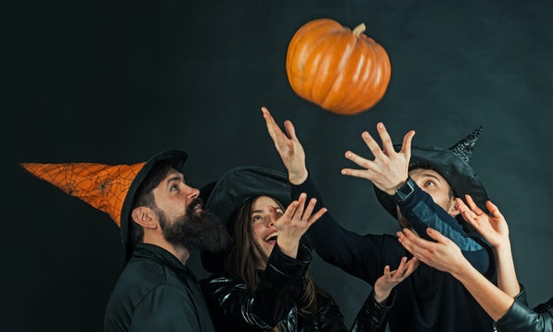 Funny friends at a Halloween party. Halloween design for copy space. Halloween party and holiday concept. Trick or treat