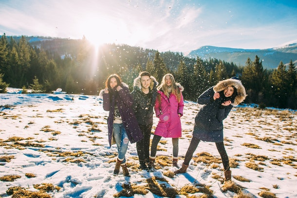 happy, joyful group of young people in the mountains