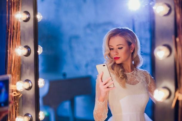 Beautiful girl taking selfie in mirror