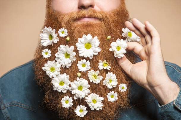 man who was able to grow a beard decorates it