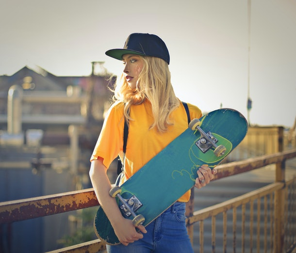 Urban girl with skateboard