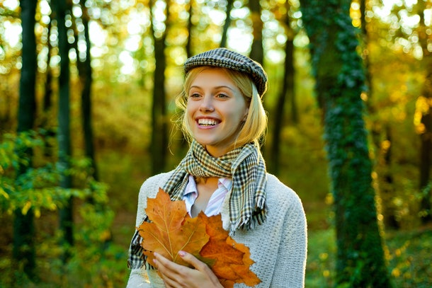 Autumn woman. Autumnal mood. Autumn woman with autumnal mood. Autumn Beauty. Outdoor portrait Gorgeous model girl with sunny day light