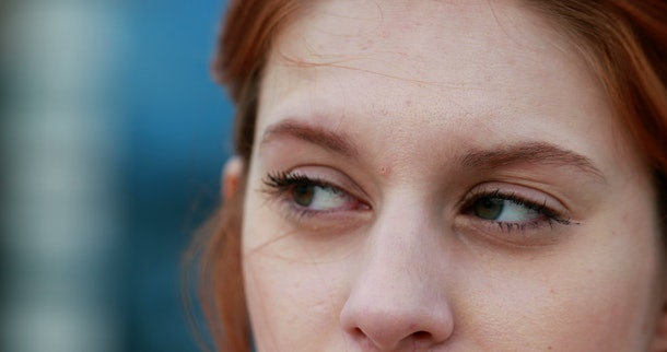 Young woman face thinking concerned about something