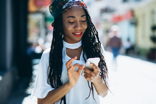 African american woman with phone