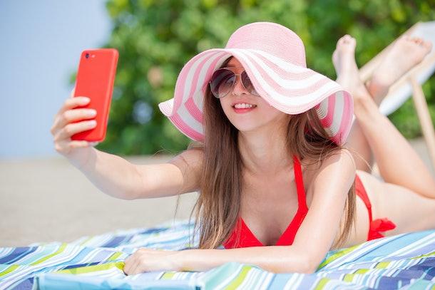 bikini woman take selfie on the beach