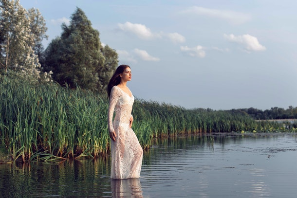 The girl in the forest near the river