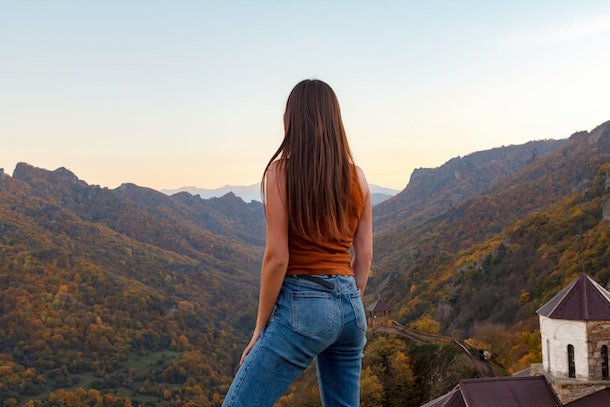 girl in the background of the autumn gorge