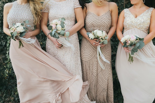 close up of nude bridesmaids dresses, flower bouquets, modern and trendy gowns, blowing in wind