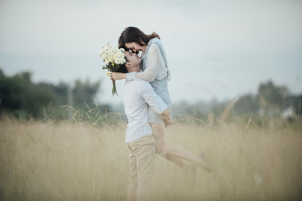 happy young couple in romance on summer beautiful landscape