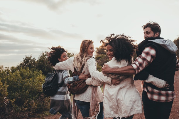 This picture of a group of friends hiking and turning around to look at the camera is a perfect pose to pair with fall puns for Instagram captions.