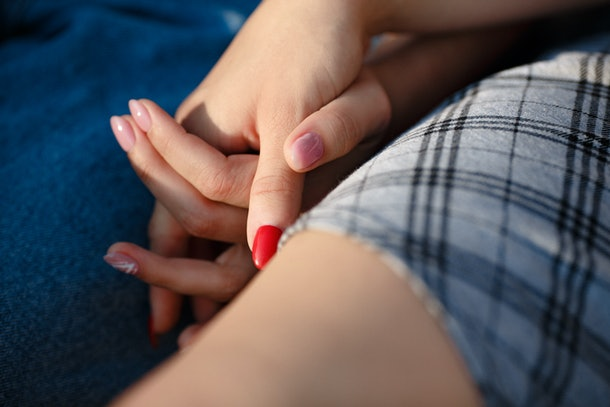 Female hands together. Gentle touch each other. Lesbian love concept.