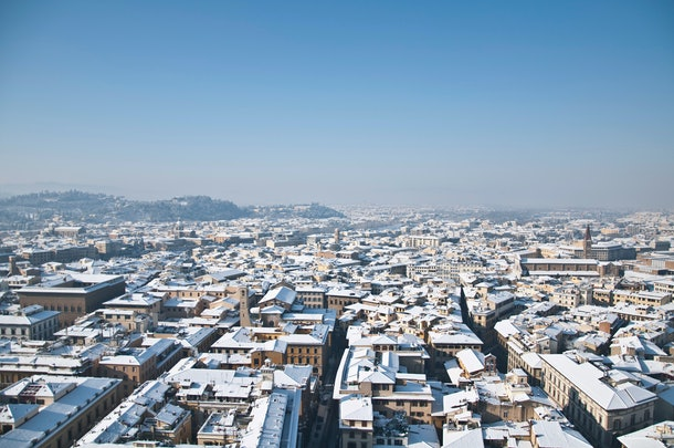 The city of Florence is sunny and snow-covered in the middle of winter.