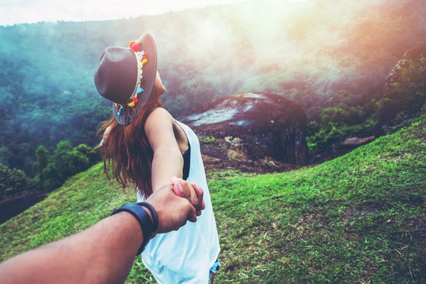 Lover women and men asians travel relax in the holiday. Hold hands running on the lawn. Wild nature wood on the mountain.