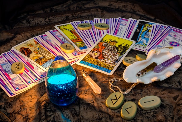 Tarot cards by candlelight in the evening