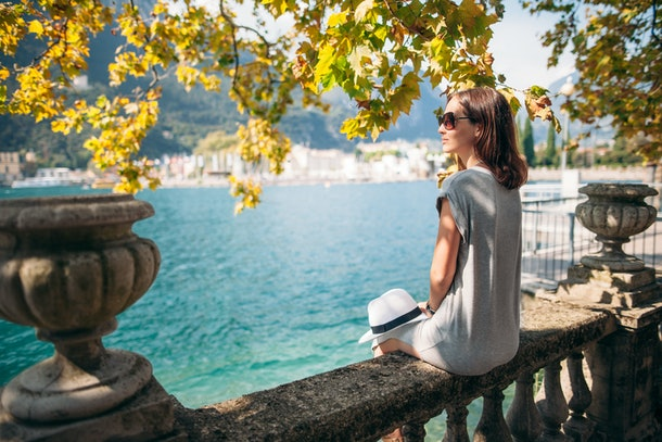 Young woman relaxing on beautiful Garda lake. vacation concept