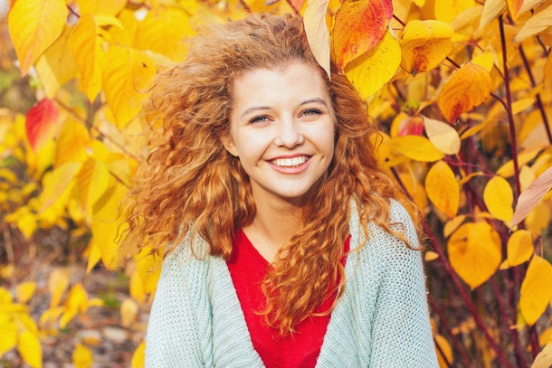 beautiful red-haired girl in the autumn park