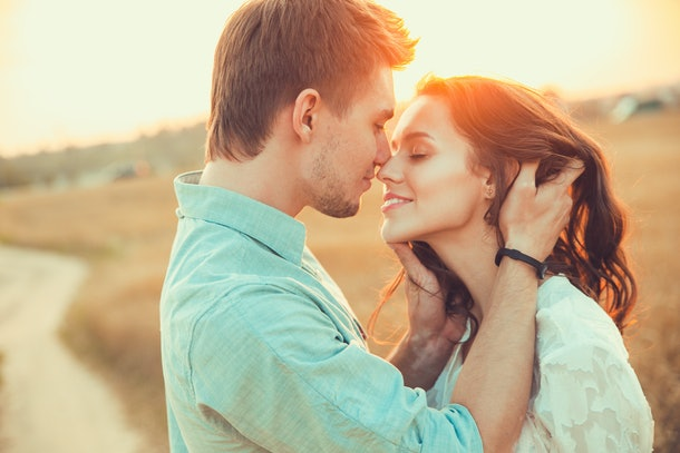 Young couple in love outdoor.Stunning sensual outdoor portrait of young stylish fashion couple posing in summer in  field