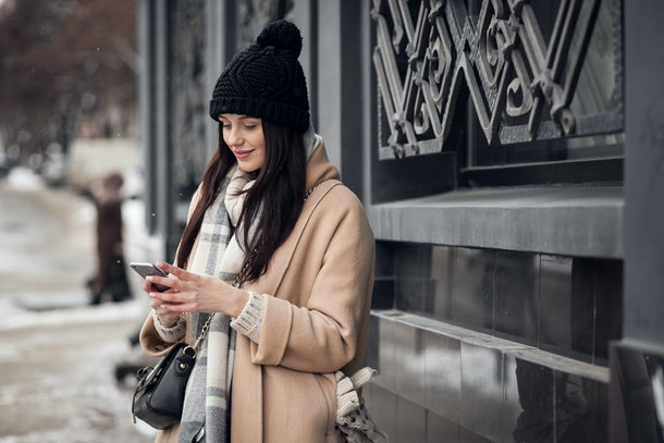 woman walking street coat face