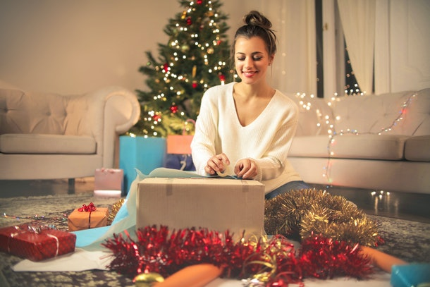 A woman wraps Christmas gifts for the holidays.