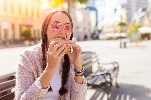 Young woman eating a sandwich